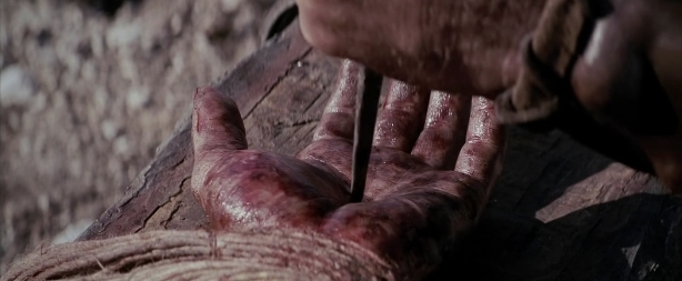 the passion of the christ - nail in jesus hand